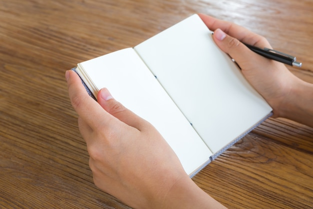 Person reading a blank book