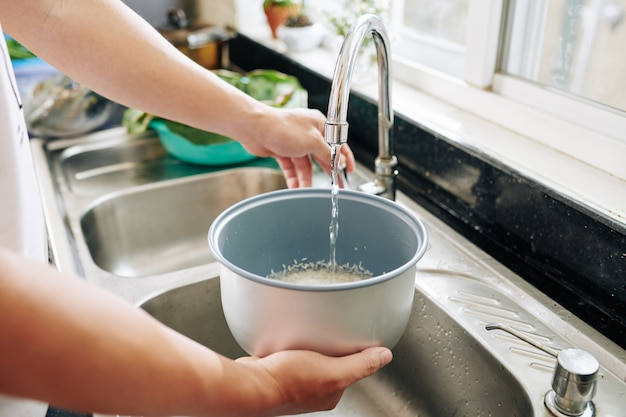 Person rinsing rice