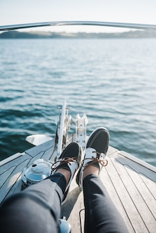 Person's feet on the boat sailing on the sea during daytime
