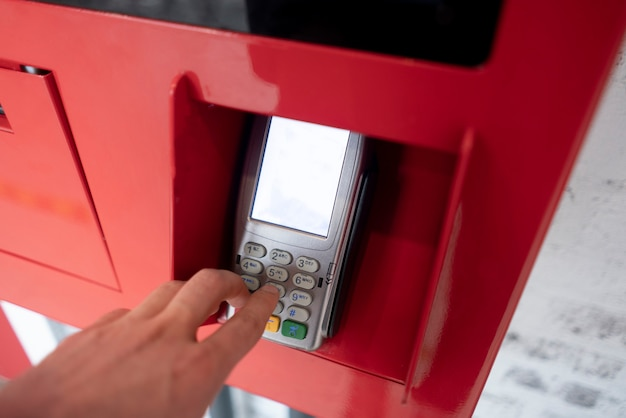 A person's hand enter password and push buttons to make a payment