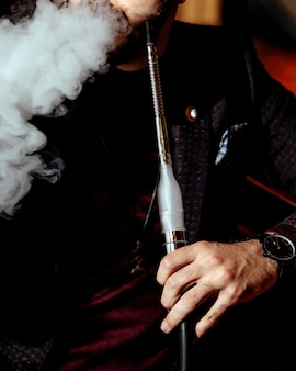 A person smoking hookah
