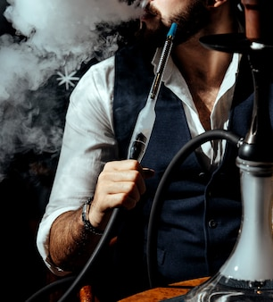 A person smoking hookah