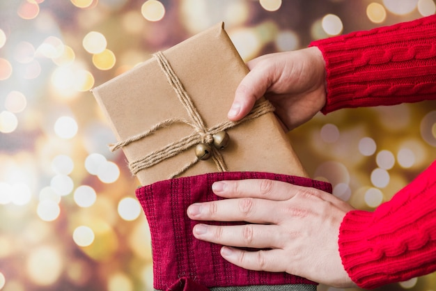 Person taking gift from christmas sock