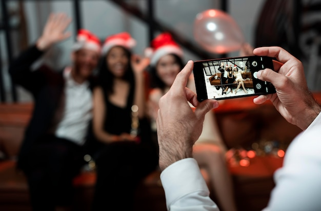 Person taking a photo of his best friends at new year's eve party