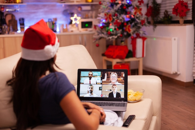 Person talking with remote friends during online videocall meeting conference