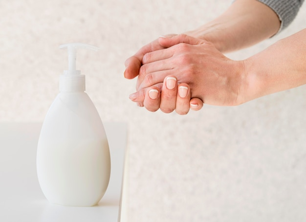 Person using disinfection solution