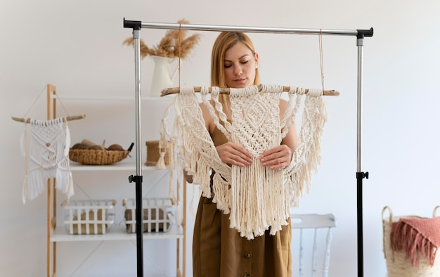 Person using the macrame technique at home