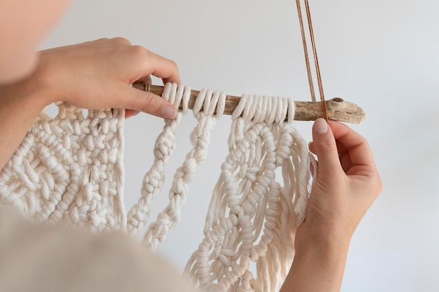 Person using the macrame technique indoors