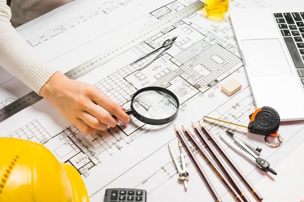 Person using magnifyeron blueprint