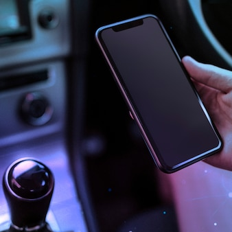 Person using a phone in a smart car