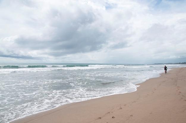 Person walking along beach in bali