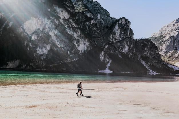 Person walking near shoreline