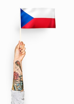 Person waving the flag of czech republic