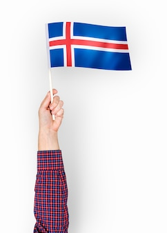 Person waving the flag of iceland