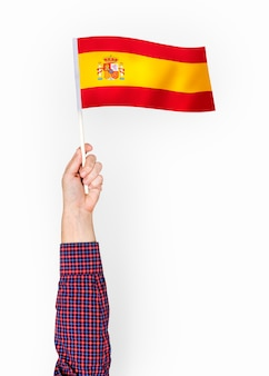 Person waving the flag of kingdom of spain