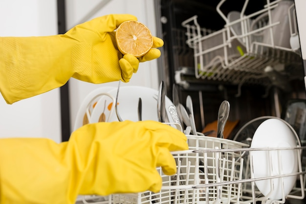 Person wearing protection gloves and doing chores
