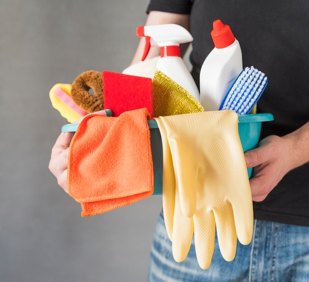 Person with cleaning products