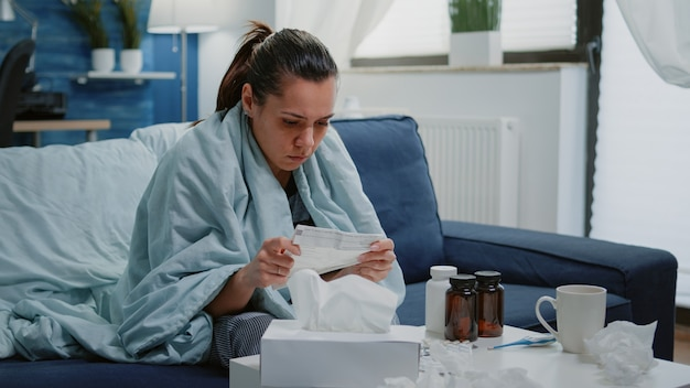 Person with disease infection analyzing package leaflet