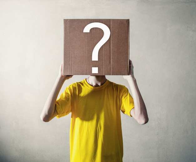 Person with overhead a cardboard box