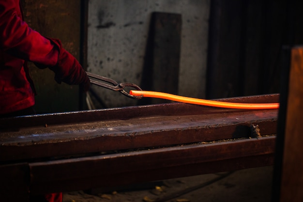 A person working with melted steel