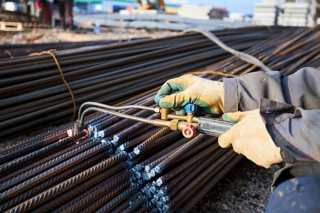 A person works with welding, sparks, close up, construction
