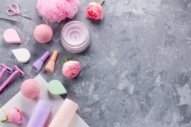 Personal care products on grey concrete background