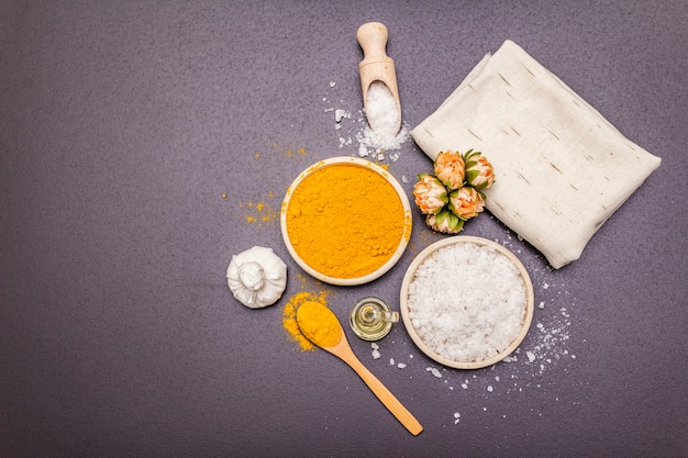 Personal care with natural ingredients. healthy spa concept. turmeric, sea salt, oil, towel.