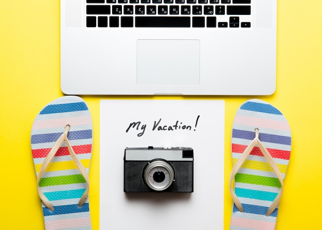 Personal computer with sandals and camera