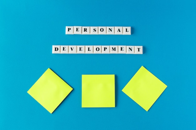 Personal development, isolated text written on a blue background and notes