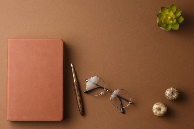 Personal diary with a pen and a potted plant