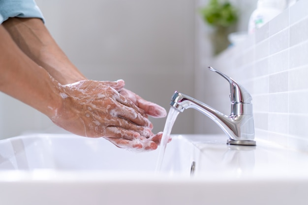 Personal hands wash with soap bubbles and rinse with clean water. good health
