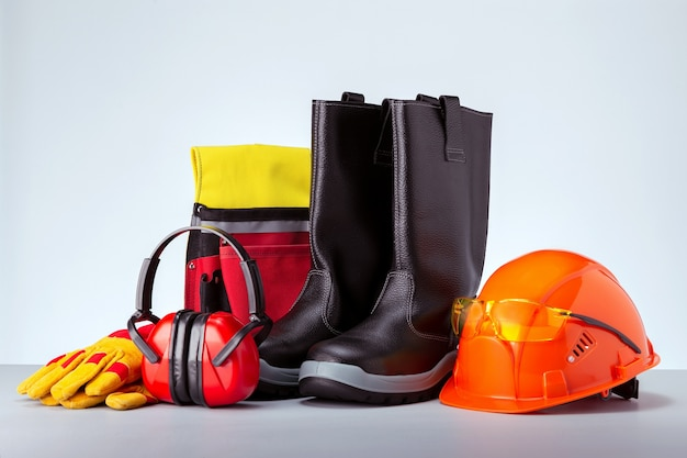 Personal protection equipment against grey wall. concept work safety.