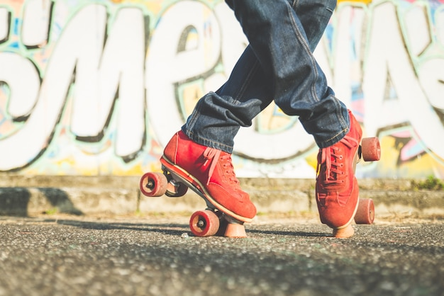 Persons legs roller skating