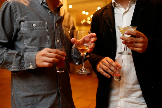 Persons with drinks glasses during an event