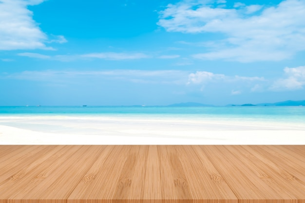 Perspective brown wooden table on top over blur sea background. beautiful sea in thailand.