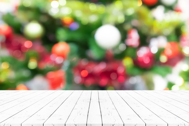 Perspective empty wooden table and christmas tree blur decoration background, for product