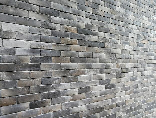 Perspective modern grey brick wall background, soft focus