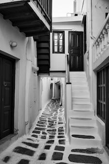 Perspective of narrow street in mykonos town, greece