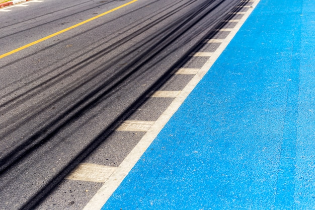 Perspective view of asphalt road, paint blue color for bicycle lane.