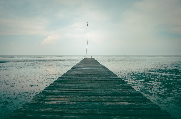 Perspective of wood bridge in deep sea.