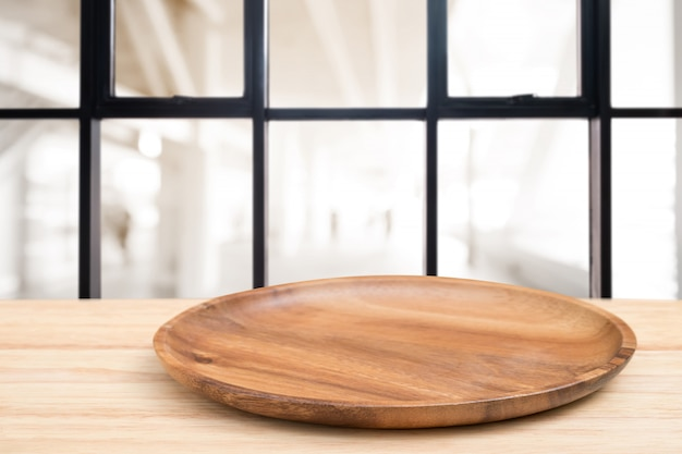 Perspective wooden table and wooden tray on top over blur coffee shop background