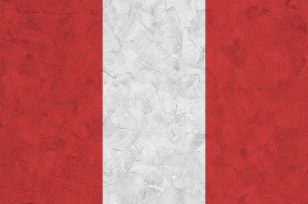 Peru flag depicted in bright paint colors on old relief plastering wall. textured banner on rough background