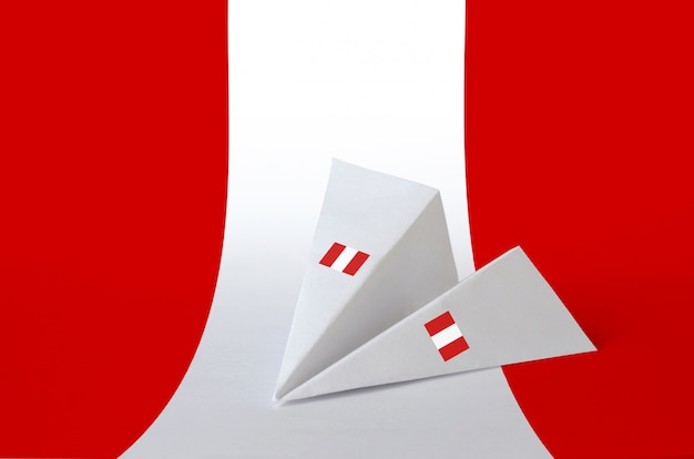 Peru flag depicted on paper origami airplane. handmade arts concept