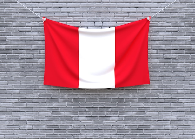 Peru flag hanging on brick wall