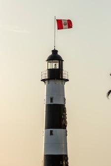 Peru flag on a lighthouse