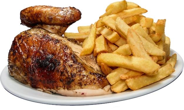 Peruvian food pollo a la brasa, french fries and rotisserie chicken