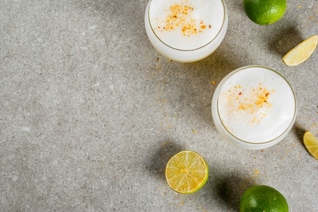 Peruvian, mexican, chilean traditional drink pisco sour liqueur, with fresh lime