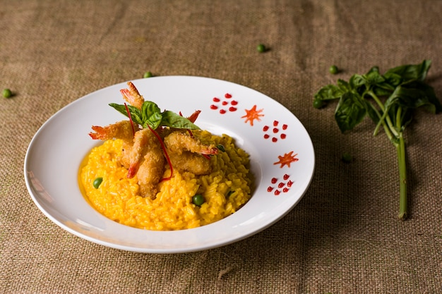 Peruvian traditional seafood  green spaghetti with prawn and shrimp and risotto  ceviche mariscos chicharron cabrilla