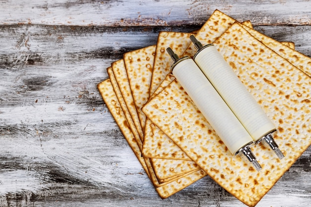 Pesah celebration concept jewish torah scroll during passover holiday matza