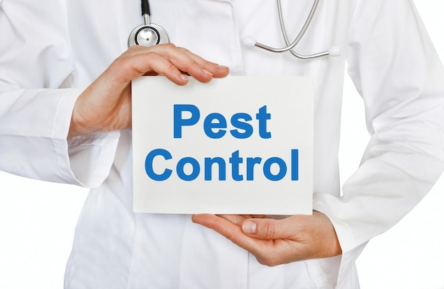 Pest control card in hands of medical doctor